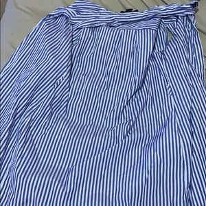 A blue and white stripped button up shirt